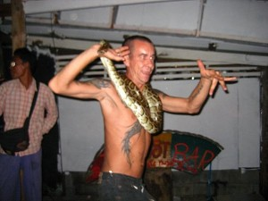 Who scarier? The guy or the snake?